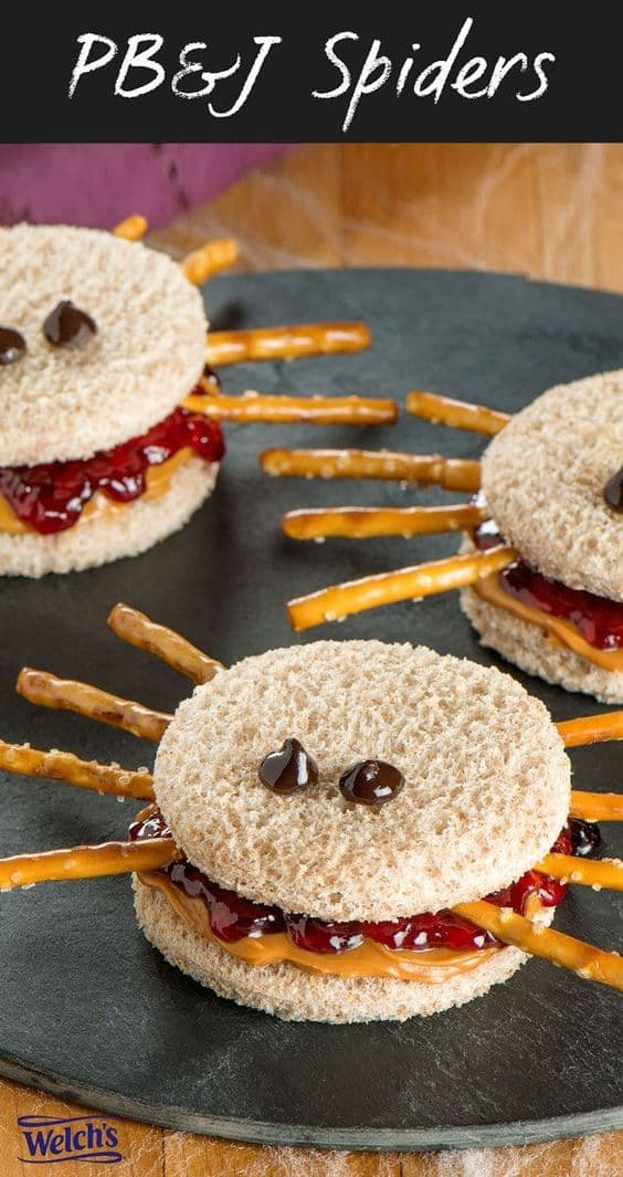 Fun Halloween Snack or Lunch idea - Peanut Butter and Jelly Spider Sandwiches.