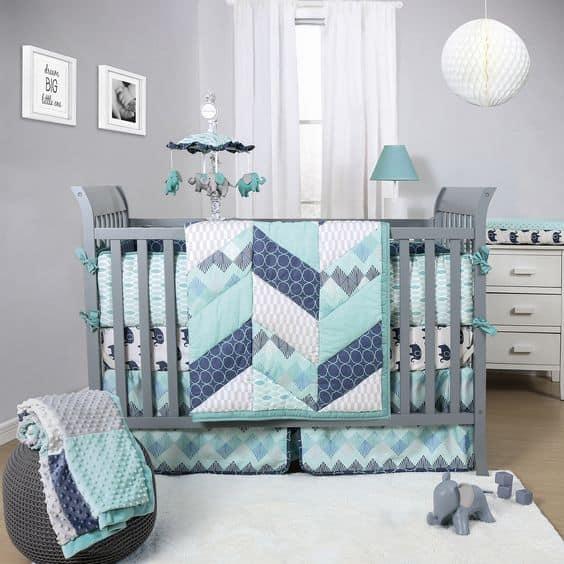 The Peanut Shell Mosaic 3 piece crib bedding set features pieced herringbone…