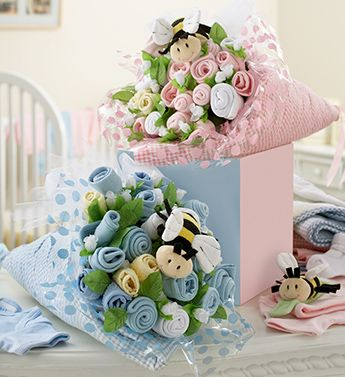 Baby Sock Flower Bouquets wrapped in baby clothes or muslin wraps so double the gift